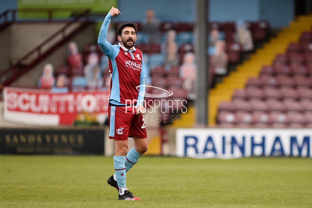 Scunthorpe United Jem Karacan (23) pointing, directing, signalling, gesture full length portrait during the EFL Sky Bet League 2 match between Scunthorpe United and Grimsby Town FC at the Sands Venue Stadium, Scunthorpe, England on 23 January 2021.