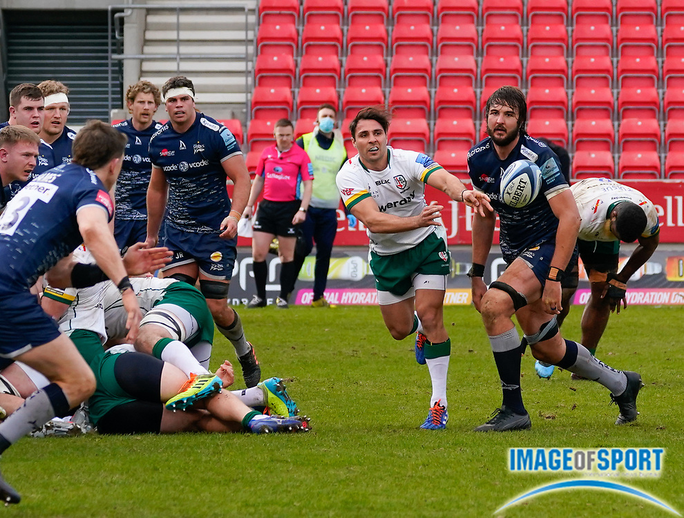 London Irish Nick Phipps passes the ball  during a Gallagher Premiership Round 14 Rugby Union match, Sunday, Mar 21, 2021, in Eccles, United Kingdom. (Steve Flynn/Image of Sport)