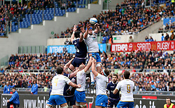 Italy's Dean Budd (right) goes for the ball during a lineout during the NatWest 6 Nations match at the Stadio Olimpico, Rome.
