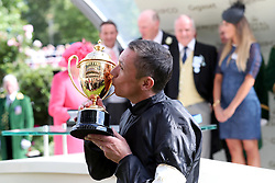 Jockey Frankie Dettori celebrates with the trophy after winning the Gold Cup with horse Stradivarius during day three of Royal Ascot at Ascot Racecourse.