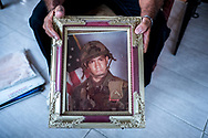 Deported U.S. Army veteran Jose Marquez displays a photograph of himself during his military service as he sits in his home in Santo Domingo, Dominican Republic, June 16, 2018.<br /> <br /> Marquez served from 1984 to 1993 and received an honorable discharge. He was later convicted of possession of narcotics on three separate occasions including 1995, 1996 and 1997. These crimes added up to an aggravated felony and he was sought for deportation in 2000. He fought his case while in immigration detention taking it all the way to the Supreme Court. He lost his case and was deported to the Dominican Republic in 2005.