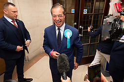 © Licensed to London News Pictures. 26/05/2019. London, UK. British Brexit party leader Nigel Farage arrives at the O2 Guildhall venue for the European Parliament results in Southampton, Britain, on May. 26, 2019.  The Brexit Party is expected to do very well in the elections. Photo credit: Ray Tang/LNP