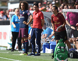 Arsenal manager Unai Emery prepares to bring on Matteo Guendouzi during the pre-season match at Meadow Park, Boreham Wood.