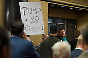 A woman holds a sign after Donald Trumps speech during FreedomFest at the Planet Hollywood Resort & Casino in Las Vegas, Nevada on July 11, 2015.