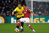 Korey Smith of Bristol City (R) dodges a challenge from Daryl Janmat of Watford (L). The Emirates FA Cup, 3rd round match, Watford v Bristol City  at Vicarage Road in Watford, London on Saturday 6th January 2018.<br /> pic by Steffan Bowen, Andrew Orchard sports photography.