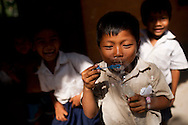 Young Cambodian pupils play with bubbles during recess at school, Angkor, Cambodia, Southeast Asia