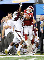 Oklahoma Sooners wide receiver Kenny Stills (4) watchs as a ball falls short while being defended by Texas A&M Aggies defensive back De'Vante Harris (1) during the 77th AT&T Cotton Bowl Classic between the Texas A&M University Aggies and the Oklahoma University Sooners at Cowboys Stadium in Arlington, Texas. Texas A&M wins the 77th AT&T Cotton Bowl Classic against Oklahoma, 41-13.