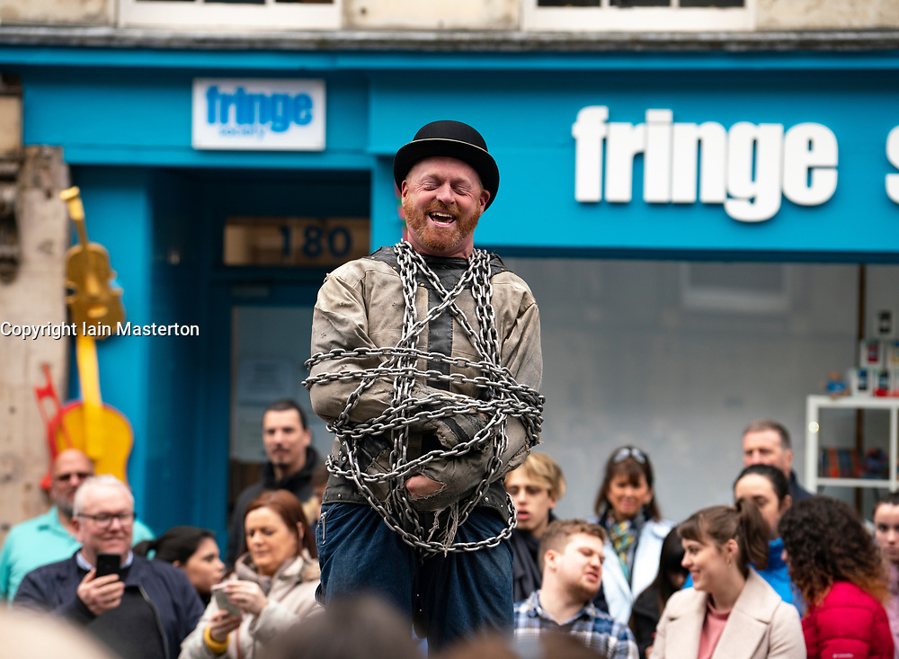 Escape artist performing to tourists on the Royal Mile in Edinburgh, Scotland UK