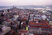 View of central Istanbul, and the Bosphorus River beyond. In the distance is the Galata Bridge over the Bosphorus, the strait between the Black and Aegean seas. Located on a narrow isthmus between two bodies of water, the Turkish city of Istanbul (formerly known as Constantinople and, before that, Byzantium) long dominated the trade between Europe and Asia. The Galata District in the foreground, a hub for both entertainment and finance, is on the European side of the Bosphorus, both geographically and culturally. Istanbul, Turkey. Muslim, Islam, Architecture...