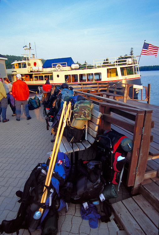 BACKPACKERS WAIT TO BOARD THE FERRY ISE ROYALE QUEEN III IN COPPER HARBOR MICHIGAN TO TRAVEL TO ISLE ROYALE NATIONAL PARK.