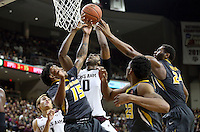 Texas A&M's Tonny Trocha-Morelos (10) fights fir a rebound against Missouri's Wes Clark (15) and Kevin Puryear (24) during the first half of an NCAA college basketball game, Saturday, Jan. 23, 2016, in College Station, Texas.  (AP Photo/Sam Craft)