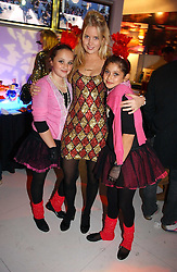 Left to right, PHOEBE SAATCHI, MARISSA MONTGOMERY and SCARLETT LESLEY at a party to celebrate the launch of DKNY Kids and Halloween in aid of CLIC Sargent and RX Art held at DKNY, 27 Old Bond Street, London on 31st October 2006.<br /><br />NON EXCLUSIVE - WORLD RIGHTS