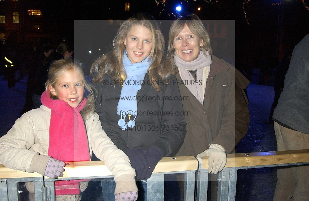 JULIER HERD and her daughters at the opening of the Natural History Museum's Ice Rink on 16th November 2005.<br />