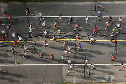 bird's eye view of runners in Cape Elizabeth, Maine during the annual Beach to Beacon 10K road race, founded by Joan Benoit Samuelson