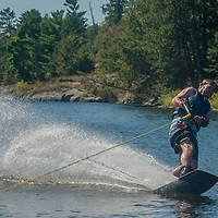 Jay Jensen rides a wake board on Lake of the Woods, Ontario, Canada.