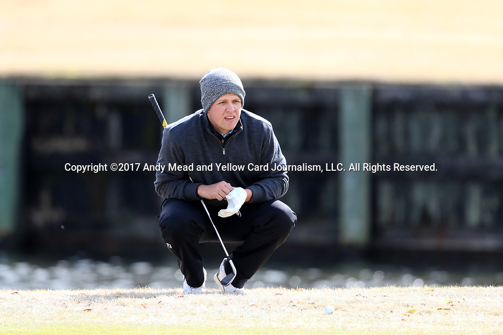 WILMINGTON, NC - MARCH 19: Kent State's Bjarki Petursson (ISL) lines up a putt on the Ocean Course seventh hole. The first round of the 2017 Seahawk Intercollegiate Men's Golf Tournament was held on March 19, 2017, at the Country Club of Landover Nicklaus Course in Wilmington, NC.