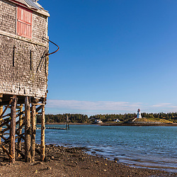 Old fish processing buildings are now a fishing museum in Lubec, Maine. Lubec Narrows.