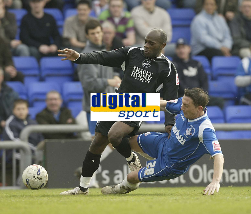Photo: Aidan Ellis.<br /> Oldham Athletic v Swansea City. Coca Cola League 1. 22/04/2006.<br /> Swansea's Adrian Forbes is tackled by Oldham's David Eyres
