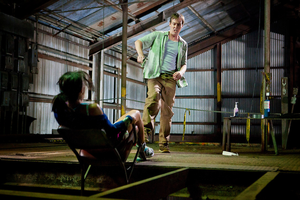 In this episode of Breakout Kings, in an attempt to throw the Breakout Kings off their track, Brent kicks the woman - chair and all - over a ledge and flees out a back door. Photo: Skip Bolen/A&E Television Networks