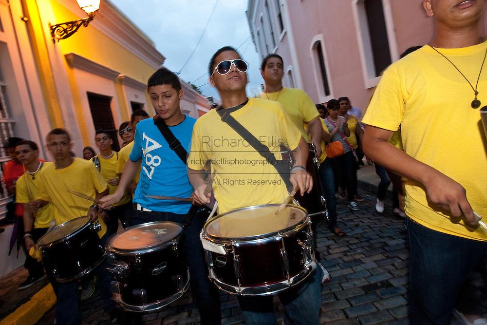 Drummers parade through the streets of Old San Juan January 13, 2011 during the Festival of San Sebastian in San Juan, Puerto Rico.