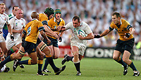 Photo: Richard Lane.<br />Australia v England. Rugby World Cup Final, at the Telstra Stadium, Sydney. RWC 2003. 22/11/2003. <br />Richard Hill fights his way through the Australian defence.