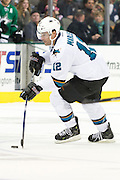 DALLAS, TX - OCTOBER 17:  Patrick Marleau #12 of the San Jose Sharks controls the puck against the Dallas Stars on October 17, 2013 at the American Airlines Center in Dallas, Texas.  (Photo by Cooper Neill/Getty Images) *** Local Caption *** Patrick Marleau