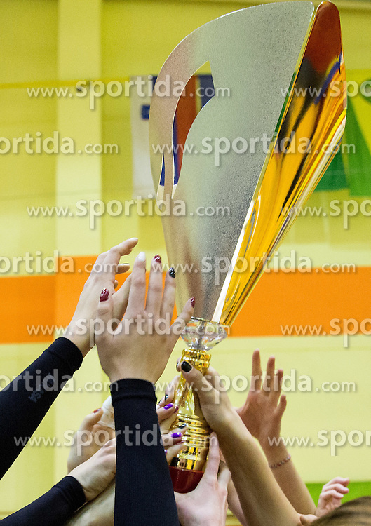 Players of Nova KBM celebrate with a trophy after the volleyball match between Nova KBM Branik Maribor and OK Luka Koper in Final of Women Slovenian Cup 2014/15, on January 18, 2015 in Sempeter v Savinjski dolini, Slovenia. Photo by Vid Ponikvar / Sportida