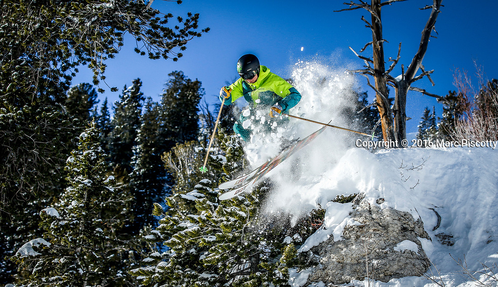 """SHOT 1/26/16 9:22:01 AM - Harrison Holley of Park City, Utah leaps off a rock face at Solitude Mountain Resort. Solitude is a ski resort located in the Big Cottonwood Canyon of the Wasatch Mountains, thirty miles southeast of Salt Lake City, Utah. With 66 trails, 1,200 acres (4.9 km2) and 2,047 feet (624 m) vertical, Solitude is one of the smaller ski resorts near Salt Lake City. It is a family-oriented mountain, with a wider range of beginner and intermediate slopes than other nearby ski resorts; 70% of its slopes are graded """"beginner"""" or """"intermediate,"""" the highest such ratio in the Salt Lake City area. Solitude was one of the first major US resorts to adopt an RFID lift ticket system, allowing lift lines to move more efficiently. (Photo by Marc Piscotty / © 2016)"""
