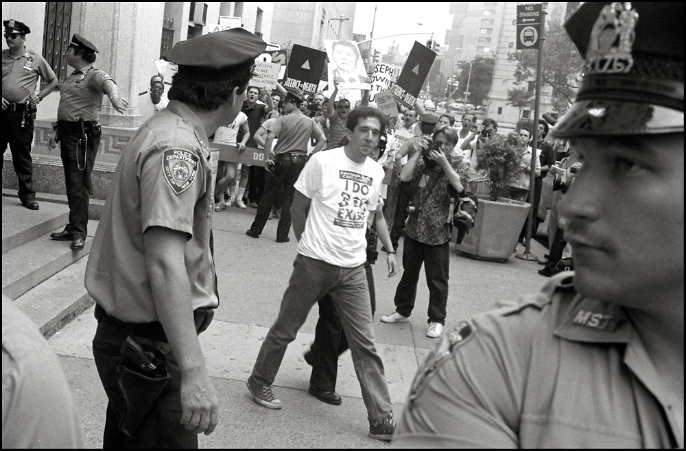 David Mayer was arrested after several ACT UP members staged a sit-in in the offices of Stephen Joseph, the New York City Commissioner of Health, as others demonstrated outside, after Joseph had suddenly halved the number of estimated AIDS cases in NYC, on July 19th, 1988 - a move that threatened to drastically reduce funding for AIDS services.