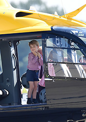 Prince George stands in a rescue helicopter, during a visit to Airbus in Hamburg, Germany with his parents the Duke and Duchess of Cambridge and his sister Princess Charlotte.