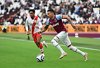 Football - 2020 / 2021 Premier League - Final Round - West ham United vs Southampton - London Stadium<br /> <br /> West Ham United's Jesse Lingard holds off the challenge from Southampton's Kyle Walker-Peters.<br /> <br /> COLORSPORT/ASHLEY WESTERN