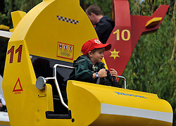 © licensed to London News Pictures. WINDSOR, UK.  09/07/11. Alastair Lancaster on the 'Chopper Squadron' ride. Penny Lancaster and her family at Legoland Windsor, today 09 July 2011. Penny Lancaster is married to Rod Stewart.  PERMISSION GRANTED BY PENNY LANCASTER FOR CHILDREN TO BE IDENTIFIED. Mandatory Credit Stephen Simpson/LNP