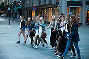 Girls out walking on a summer evening in downtown, Bergen, Norway
