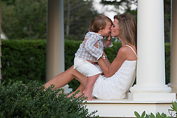 mother and little boy enjoying time together on a porch