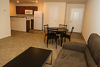 Spacious living room / kitchen area in a two bedroom apartment unit available for students at Lakes Region Community College.  (Karen Bobotas/for the Laconia Daily Sun)