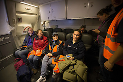 """""""Flying"""" grooms the happy few who are allowed to attend there horses during flight<br /> Departure of the horses to the World Cup Finals in Las Vegas from Schiphol - Amsterdam 2015.<br />  © Hippo Foto - Dirk Caremans"""