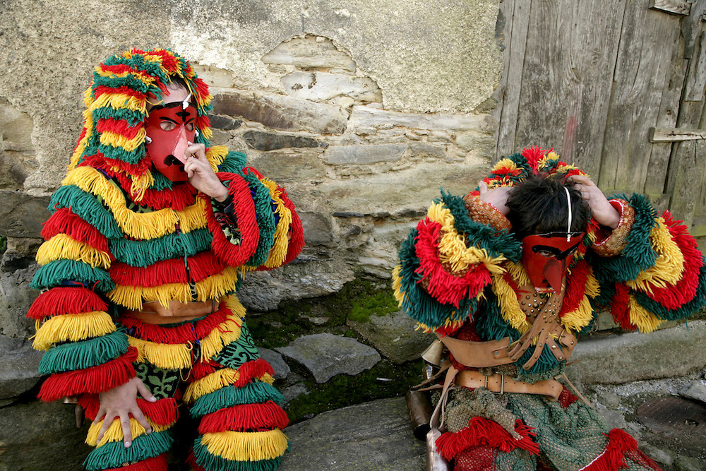 """Two men dressing the """"Careto"""" costume. Men and boys wear a wool suit that was usually handcrafted by the owner when he was an adolescent and traditionally women were not allowed to participate."""