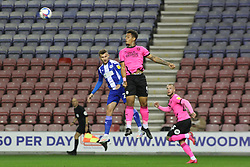 Jonson Clarke-Harris of Peterborough United out jumps Tom James of Wigan Athletic in the air - Mandatory by-line: Joe Dent/JMP - 20/10/2020 - FOOTBALL - DW Stadium - Wigan, England - Wigan Athletic v Peterborough United - Sky Bet League One