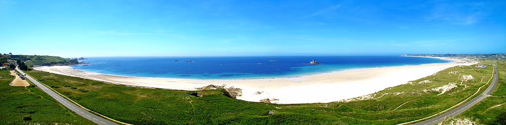 View of the coastline at St Ouen's Bay in summer, Jersey, Channel Islands with its white sand and turquoise calm, clear water