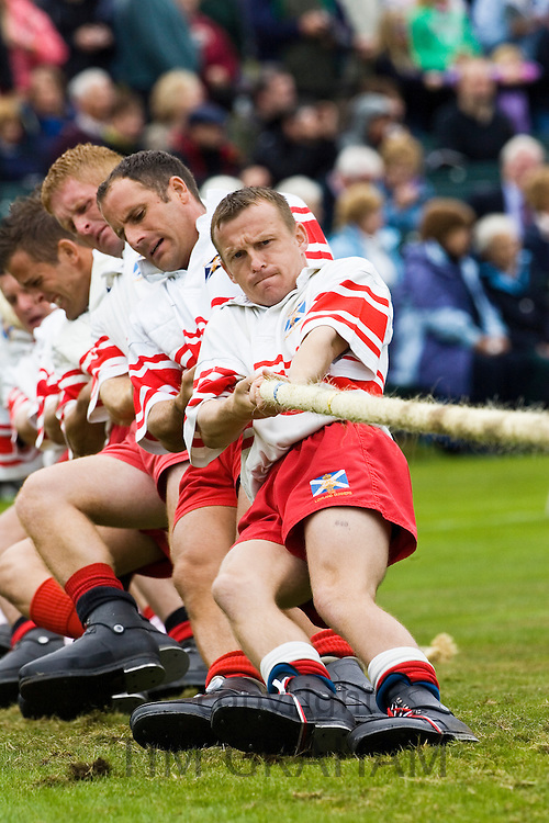 Men compete in Tug O' War contest at the Braemar Games Highland Gathering, Scotland, UK