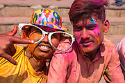 Celebrating Holi, a Hindu festival celebrating spring and love with colours. Photographed in Varanasi Uttar Pradesh, India