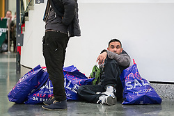 © Licensed to London News Pictures . 26/12/2015 . Manchester , UK . Bargain hunters with bogs of shopping inside Manchester's Arndale Centre , at the start of the annual winter sale . Photo credit: Joel Goodman/LNP