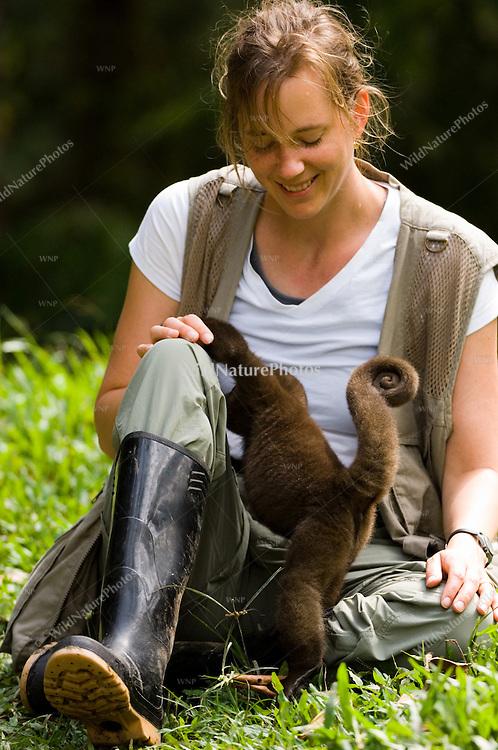 A photographer and a Woolly Monkey bonding; Napo, Ecuador