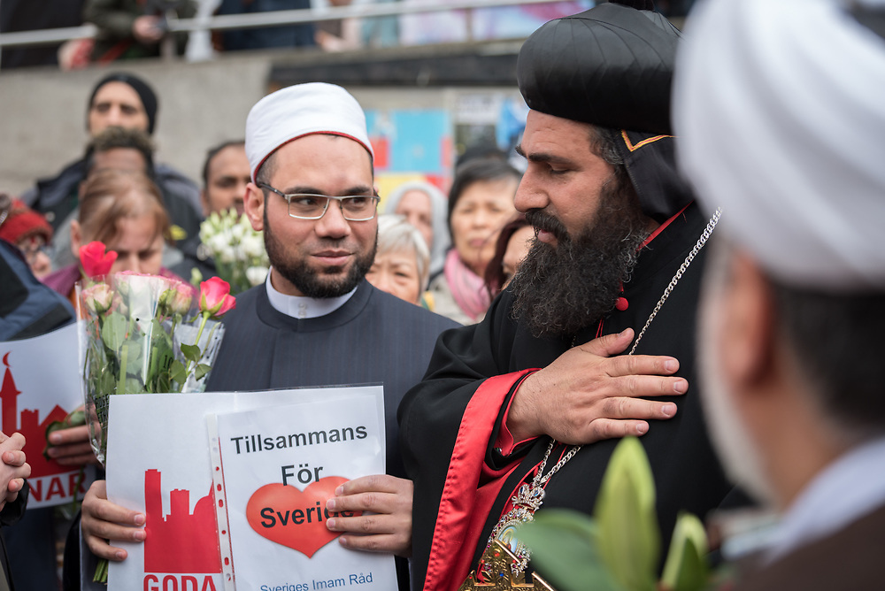 10 April 2017, Stockholm, Sweden: Three days after a lorry was driven into a store in central Stockholm, killing at least four people and injuring many more, an interreligious service was held at Sergels torg in central Stockholm, to commemorate the victims of violence, and to pray together, for a future of compassion and peace together. The event was attended by representatives of a range of religions present in Stockholm and Sweden as a whole. Here, Archbishop Benyamen Atas (right) from the Syrian Orthodox Church in Sweden, and Egyptian Imam Khaled Eldib (left) from the Stockholm Grand Mosque, Sweden. Oral consent obtained for use by Church of Sweden and the World Council of Churches.