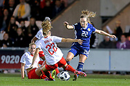 Luana Buhler (#22) of Switzerland slides in to win the ball from Erin Cuthbert (#22) of Scotland during the 2019 FIFA Women's World Cup UEFA Qualifier match between Scotland Women and Switzerland at the Simple Digital Arena, St Mirren, Scotland on 30 August 2018.