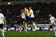 Darren Pratley of Bolton Wanderers  heads the ball away from danger. Skybet football league championship match, Bolton Wanderers v Huddersfield Town at the Macron stadium in Bolton, Lancs on Saturday 29th November 2014.<br /> pic by Chris Stading, Andrew Orchard sports photography.