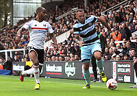Football - 2016 /2017 Championship - Fulham vs Queens Park Rangers<br /> <br /> Sone Aluko of Fulham and Joel Lynch at Craven Cottage<br /> <br /> <br /> Credit : Colorsport / Andrew Cowie