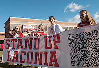 """The Freshman class rallies their fellow students for the Laconia High School """"Pride"""" Homecoming Parade Friday afternoon.  (Karen Bobotas/for the Laconia Daily Sun)"""