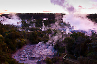 The 30 meter high Pohutu Geyser erupting at sunrise, Te Puia (New Zealand Maori Arts & Crafts Institute), Whakarewarewa Thermal Valley, Rotorua, North Island, New Zealand.