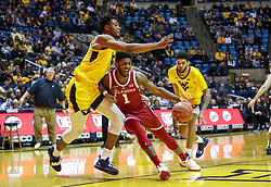 Feb 2, 2019; Morgantown, WV, USA; Oklahoma Sooners guard Rashard Odomes (1) drives down the lane while defended by West Virginia Mountaineers forward Derek Culver (1) during the first half at WVU Coliseum. Mandatory Credit: Ben Queen-USA TODAY Sports